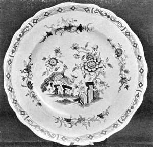 "A Chamberlain Worcester Plate: Here the decoration for a large dinner service, of which this is one plate, includes both Chelsea birds and lotus flowers from the Imari patterns. Done in full colors, it was made circa 1825 and bears the impressed mark ""Chamberlains' Worcester."" - courtesy American Art Association-Anderson A Galleries"
