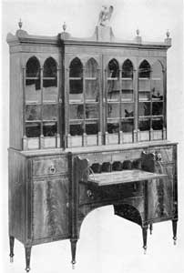 "Illustration II: A Fine Salem Break-Front Secretary: This is an example of the high standard of Salem cabinets shipped South. It originally belonged in the English family. Their home was in the ""Mary Land Tract"" between Frederick and Brunsurick, Maryland."