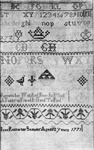 """Illustration IV: An American Sampler of 1771: This is typical of the needlework of little girls of America in the last quarter of the 18th Century. It has letters, numerals, and stylized forms. From the scepter and crown in the upper part, one may infer that """"Jane Rutter, aged 12,"""" was loyal to the English crown."""