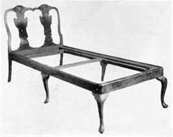 A Queen Anne Day Bed: The double splat of the back, shell carvings on the knees of legs, and cresting of the top, are characteristic details with the elaborate work of the period. Of Philadelphia origin, it was made of mahogany.