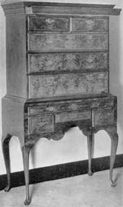 ILLUSTRATION VI: A Queen Anne Flat-Top Highboy: The drawer concealed behind the cornice molding has been opened to show its size and location.
