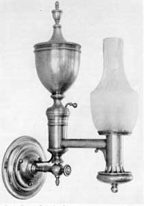 An Elaborate Brass Wall Lamp Made Of And Equipped With Argand Burner