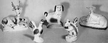 "Characteristic Pennsylvania Chalk Animal Figures: All except the squirrel with nut in fore paws are like Staffordshire pottery figures made at least a half century earlier. The reclining deer, impressed ""1883-15c."" ressembles those of Bennington pottery. The spaniel is posed like a Staffordshire example. The others are akin to animals made in redware and stoneware by the 19th-Century Pennsylvania potteries. The rooster is dated 1879. As the animals are hollow, a coin slot was sometimes cut in the back for use as a penny bank. These animals were often made in facing pairs. All date from about 1850-85."