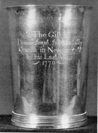 "Communion Cup, by Cario: Made by William Cario II, it was a bequest to the church in Newmarket, New Hampshire, where this silversmith worked after leaving Portsmouth. The inscription reads: ""The Gift of Deacon Joseph Judkins, to the Church in Newmarkett, by his Last Will 1770."""