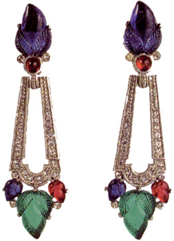 "Earrings, pendant, glass, wm, rhinestones, c.1980, ""fruit salad"" motif, surrmounts of molded dk blue glass flower buds with sm red glass cabs flanked by colorless r.s. at the base, each suspending an open lobed tapered drop pave-set with colorless r.s., terminating in a lg molded green glass bud center stone flanked by a sm dk blue and a sm red molded glass bud, rev of drop mkd - photo courtesy Xcentricities, Beverly Hills, CA"
