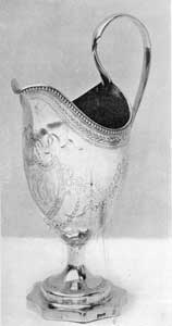 A Gilbert Cream Pitcher: The shaping of the base, in concaved octagonal form, is unusual. The touch-mark, Gilbert, in script, can be seen on the side of the base.