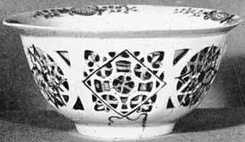 Illustration I: Earliest White Dresden Porcelain: This bowl, six inches in diameter and unmarked, was made circa 1712. It was copied from a Chinese model with double sides. The outer one was worked a jour. Decorated with lacquer painting in four colors.