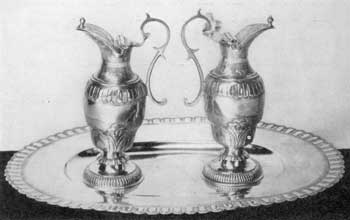 Illustration I: Ewers and Basin by Paul Lambert or Sieur Saint-Paul: This pair of ewers and basin were made by this Quebec silversmith circa 1725 for the Indian mission of Lorette. The basin is oval in shape. It is twelve inches long and nine inches wide.
