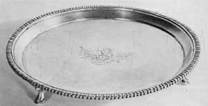 A Footed Silver Salver by Gilbert: This piece bears the Bayard crest, engraved in the center. Originally, it belonged to Nicholas Bayard (1736-1798), who had married Catherine Livingston.