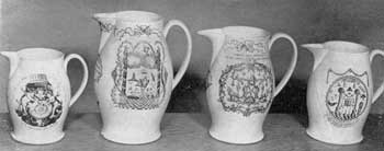 Four Liverpool Masonic Pitchers: All have black transfer decoration. Figure 4: a rare pitcher with design by P. Lambert; Figure 5: large pitcher, dated 1798; Figure 6: pitcher with Masonic coat-of-arms and many emblems; Figure 7: a seaman's jug with circular design incorporating numerous Masonic emblems.