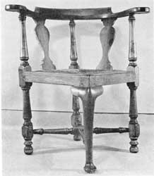 Illustration IX: Of the commode type, this mahogany chair has always been part of the office furniture of the Walter Baker chocolate mill in Dorchester, Massachusetts. Records of other chairs purchased by Dr. James Baker in 1771 from Ezra Badlam, Boston cabinetmaker, suggest that he may also have acquired this one at the same time.
