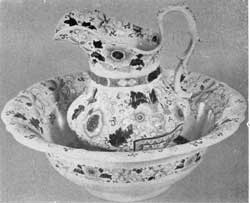 1. Ironstone china ewer and bowl in the Persian floral pattern, part of a toilet set made in England about 1851. Used by Irving.