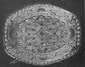 Illustrion I - A Truly Representative Piece of Lacy Glass: No other Sandwich dish is more superb in its lacelike appearance than this. It is oblong in shape and shallow and combines both beauty and rarity. The shell-like motif predominates. The dimensions are 10.75 by 9 inches.