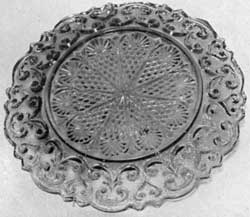 Light Olive-Green Plate: The design of the center is a Roman rosette.