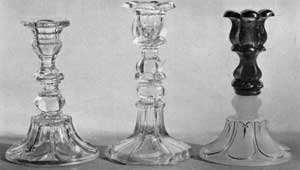 Loop-and-Petal and Baluster Candlesticks: Left to right, a loop-and-petal base and baluster top; center, loop-and-petal top, baluster base; right, all loop-and-petal with milk white base and blue top. The latter has original gold leaf decoration.