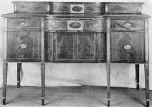 Side-board Made at Charleston, S. C.: This piece has a double deck. The shaping of this and that of the front are identical. Some sideboards with these features were made in England, but in America they were made only by the cabinetmakers of Charleston.