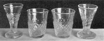 Illustration V: Miniature Flip and Cordial Glasses: All are undoubtedly of Sandwich origin. The flip glasses, or toy tumblers, are two and one-quarter inches high; the cordial glasses, two and one-half inches high.