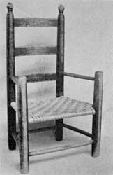 Miniature for a Child: The simple legs, arms, slats, and stretchers are typical of small chairs made in New England until well into the 19th Century.