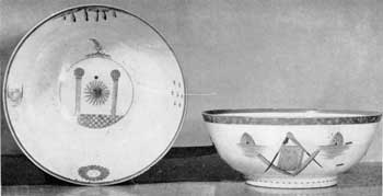 Pair of Lafayette Punch Bowls: Of Oriental Lowestoft, these were used in 1824 when General Lafayette was made a member of the Columbian Commandery of the Knights Templars of New York City. Decoration in gold and enameled colors; Figure 12: interior of bowl showing pair of Columns and Sun; Figure 13: Exterior showing Square, Compass, Bible, and pair of Beehives.