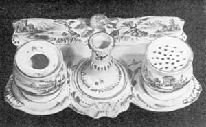 Illustration IV: Porcelain Inkstand: Fashioned after the silver models made about 1740-1750, this specimen was made at Derby about 1760. It is simple in design and contains a sandbox, eliminated in the later models which became more ornate.