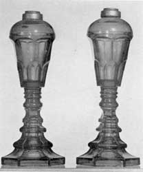 Sandwich Glass Lamps: Of cobalt-blue pressed glass, these originally had burners with double-wick tubes that screwed into the metal collar at the top of the font. They were used first for whale oil and later for the more improved types of illuminants