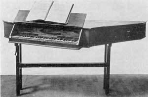 Illustration VI: Spinet by Samuel Blythe: This was made in Salem in 1789. Blythe, 1744-1795, was born and died in Salem. It is not known from whom he learned to make spinets, harpsichords, and stringed instruments. This spinet has his name and town lettered on the lower edge of the decorative front panel.