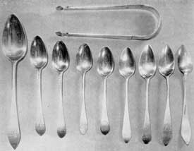 "Spoons and Sugar Tongs by Samuel Drowne: He was the first of his family to follow the silversmiths' craft in Portsmouth. His dates were 1749-1815. The spoon identified as Number 5 is the earliest. It was made for Captain Lear, father of Colonel Tobias Lear, secretary to General George Washington, and bears the Lear crest. Numbers 2 and 3 are excellent examples of Drowne's ""feather-edge"" work. They, and Number 1, were made for the Treadwell family of Portsmouth. Number 9 has been reversed to show one of his known marks, ""S. Drowne"" in rectangle."
