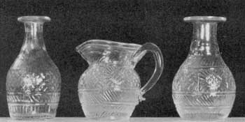 Illustration VI: Toy Decanters and Cream Pitcher: These decanters, at most, hold one-quarter pint. The cream pitcher and the decanter at the right are of the same pattern and could have been made from the same mold.