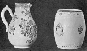 Two Periods Compared: At the left, a cream pitcher, 6 inches tall, brought from England in 1767. The flowers are very clear pink and purple, the deeper border is pink, and the whole decoration picked out with gold. The mug at the right, 5 inches tall, is in blue and gold and bears the cipher SD. It dates about 1802.