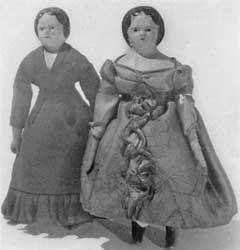 Illustration VI: Two Walking Dolls: Here costume and style of hair dress proclaim the era in which these two little figures were made.