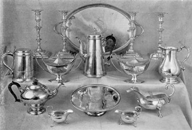 Typical Pieces of Georgian Table Silver: These pieces are – top to bottom, left to right – Tray by Edward Jay, London 1791; four candlesticks, William Cafe, London, 1762; tankard, James Bell, London, 1716; pair of covered gray boats, Henry Cowper, London, 1788; coffee-pot, Gabriel Sleath, London, 1737; ewer, Jacob Marshe, London, 1773; teapot, William Bayley, London, 1798; patten, John Eckfourd, London, 1702; gravy boat, John Lupp, London, 1746; and pair sauceboats, James Stahl, London, 1777.