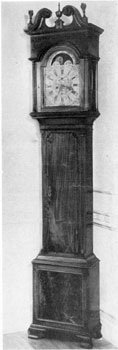 1. Scroll-pedimented tallcase clock, c. 1775. The top and fretwork just below cornice are in keeping with those on highboys and chests-on-chests in the Philadelphia Chippendale style.