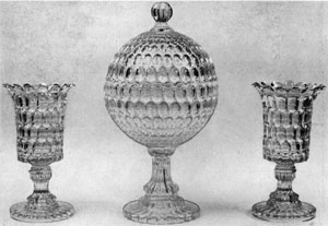 3. Pair of 16-inch celery vases and a globular compote in the Thumbprint pattern. Their grace and brilliance are similar to English or Irish cut glass. Probably made by Bakewell, Pears, and Company in the '60s.