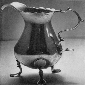 3. Georgian-style cream jug, by William Faris, all its features — body, lip, handle, feet — finely proportioned, Made about 1770.