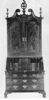 4. Secretary-bookcase, c. 1775, with a pitch scroll top not unlike tops of 18th century highboys. Use of solid doors is unusual.