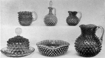 5. Group of cranberry or rose-opalescent examples in the Hobnail pattern. The pointed nodules indicate that they date among the earliest pieces produced in this pattern. Probably made by the Hobbs, Brocunier Company of Wheeling, West Virginia.