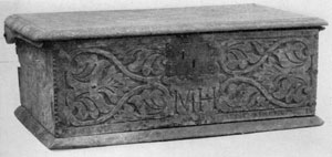 Illustration I: American Bible Box: Made about 1650, it is of oak and ash with characteristic shallow carving on front. The initials M. H. are those of the original owner.