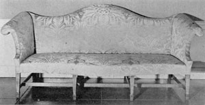 An American Chippendale Sofa: Probably made in Philadelphia, the tapered legs with spade feet have unusual lines of inlay. This piece was formerly owned by the Rutgers family, New Brunswick, New Jersey.