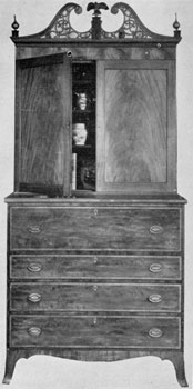 An American-Made Secretary: Probably by John Seymour & Son, Boston, this piece decorated with crotch-grain mahogany veneer, satinwood banding of drawer fronts, and delicate lines of inlay as well as ivory keyhole plates, shows how the Hepplewhite style could be adapted by a skilled American cabinetmaker.