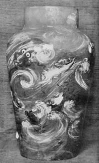 Illustration II: Another Early Rookwood Vase: Signed by the maker, Valentine, and bearing the date 1883, it is typical of the experimental stage of this pattern. The artist who made it later became one of the finest artists who worked at Rookwood.