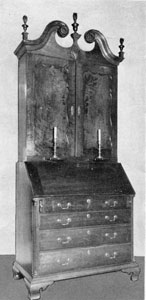 A Bachman Secretary: This Bachman secretary was made by John Bachman I, about 1795. It displays almost no carving, but retains the almost typical Bachman finials and footing.