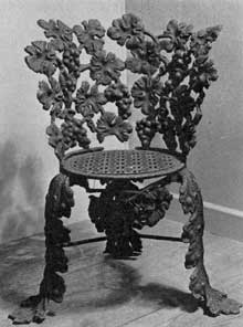 Chair in Grape Design: Leaves, bunches of grapes and vine tendrils were carefully arranged to form the structure of the wrought-iron chair with circular seat.