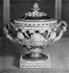 Large Chamberlain Worcester Covered Urn: Done in bleu-du-roi as the color of the background, it has a highly embossed design of figures, grapevines, and twig handles finished in flat burnished gold.