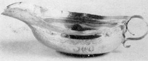 "Illustration VIII: Early 19th-Century Pap Cup: William Thomson worked in New York as a silversmith until 1834. His touch-marks were frequently ""W. Thomson"" in script letters, ""New York"" in Roman capital letters, and the year the piece was made in Arabic numerals."