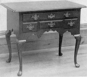 An Early Chippendale Lowboy: While often made to match a highboy, lowboys were largely used as dressing tables. The size and number of drawers made such pieces most convenient for this use.