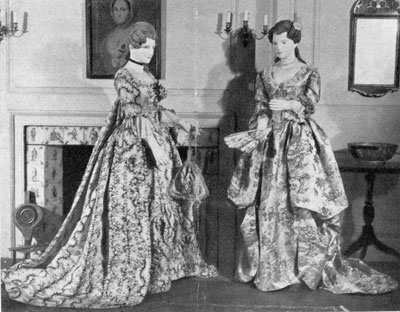 Ball gowns worn in New York in 1780: Left, a white ribbed satin patterned with green vines and pink flowers; right, a yellow satin with natural-color designs of trees, houses, flowers and birds.