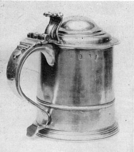 George I tankard engraved with the Newland arms, Petley Ley, ent. 1715, London.