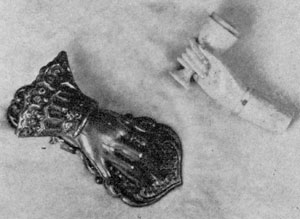 Hand Motif in Useful Objects: Upper right, bone pipe with hand holding the bowl; lower left, a brass paper clip.