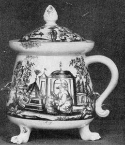 Illustration VIII: By An Unknown Artist: This round vessel on three paw feet with cover and handle has a Chinoisserie decoration in iron red probably done at Meissen early in the 18th Century.