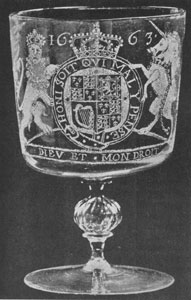 "Illustration I: The Royal Oak Goblet: Decorated with line and diamond cutting, this goblet, dated 1663, bears the royal coat-of-arms of Charles II, a portrait of him and his bride, Catherine of Braganza. There is also a depiction of the king hiding in the Boscobel oak and the legend ""Royal Oak."" Made to celebrate the marriage of Charles II and Catherine. Probably the work of the Venetian glass blowers employed in the glass house established by the Duke of Buckingham at Greenwich."